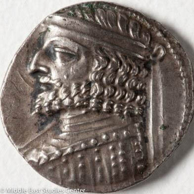Image of ancient Iranian coin depicting head of a man.